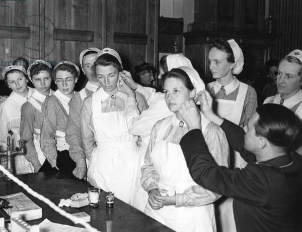 Red Cross nurses during a blood test, 1940 (b/w photo)