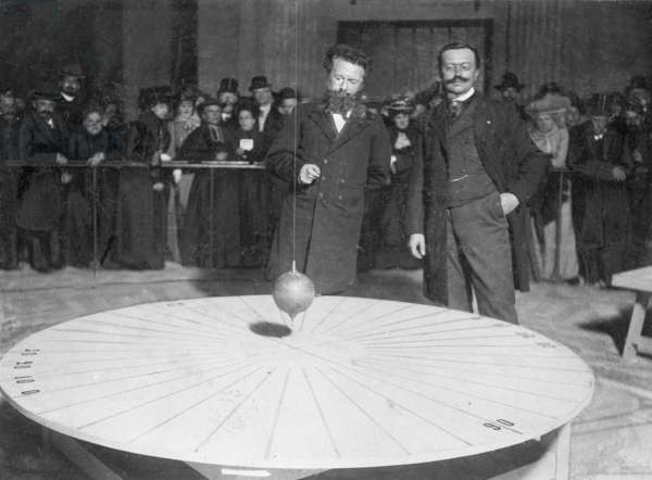 Camille Flammarin at the Foucault pendulum, 1901 (b/w photo)