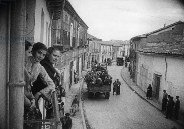 Troops marching through a Spanish village, 1936