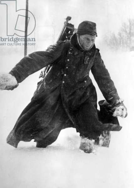 German soldier knee deep in snow, during the retreat of German troops at the Battle of Moscow, 1941 (b/w photo)