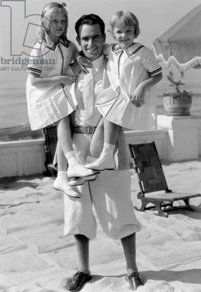 Harold Lloyd with his daughters, 1932 (b/w photo)