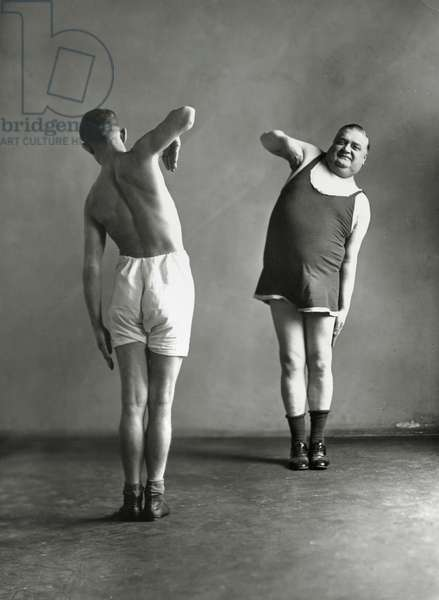 Two men doing their gymnastic exercises, 1936 (b/w photo)