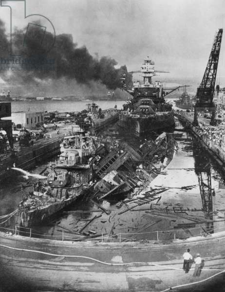 USS Pennsylvania, behind the wrecked USS Cassin and USS Downes, following the Japanese Raid on Pearl Harbor, 1941 (b/w photo) (b/w photo)