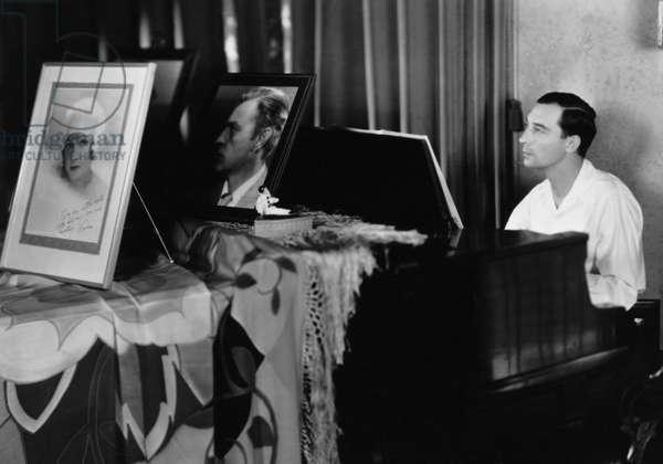 Buster Keaton playing piano (b/w photo)