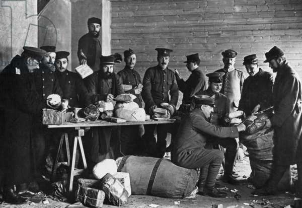 Mail check in a prisoner of war camp, 1915 (b/w photo)