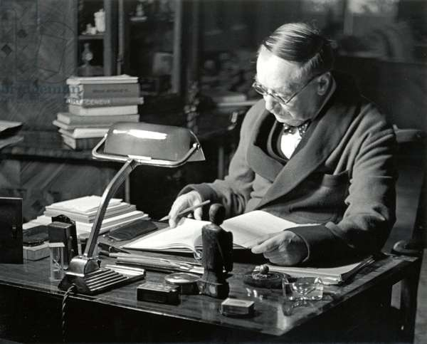 H G Wells at writing desk