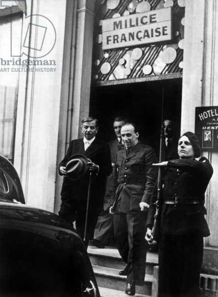 In Vichy, France : Pierre Laval, leader of the Vichy government, has attended a meeting about militia, he's with Francis Bout de l'An (general secretary of French militia), behind is Joseph Darnand, january 1943