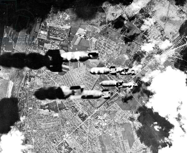 View of bombs dropping from american Flying Fortress : Allied bombings on Rouen (Normandy, France) in may 1944 to destroy briges