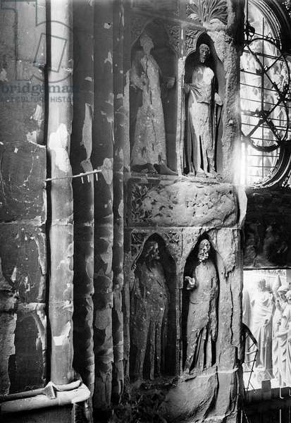Ruins of French city Reims : View of south porch statues and sculptures of the cathedral after german bombings in 1914