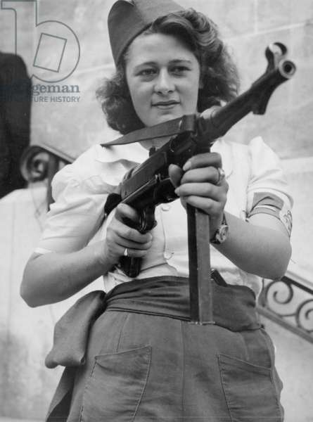 Simone Sigouin (18 years old), a young resistant who captured and liquidated Nazis 3 days earlier in Chartres, poses here with his automatic machine gun Schmeisser MP40 on 23 August 1944 at La Liberation (she wears a phrygian hat and is part of the group Freestireurs partisans according to her armband) photo of Jack Belden- French partisan who captured 25 Nazis in the Chartres Area in addition to liquidating others here during the Liberation august 23, 1944