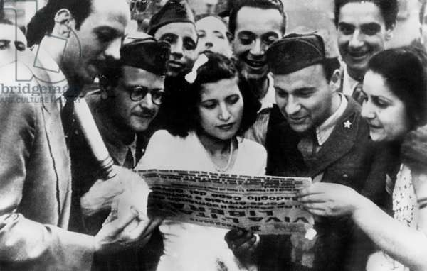 Italian civilians reading newspaper after liberation of Rome and Italy by the Allied and the announce of new government june 1944