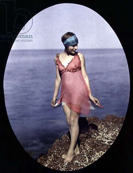 Young woman on a rock at the sea, autochrome by Lumiere brothers c. 1920 (color photo on glass, 1st color photography process invented in1903)