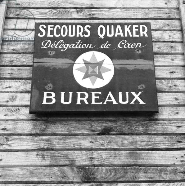 brass plate of the Quaker aid office in Caen Normandy, France, october 1944