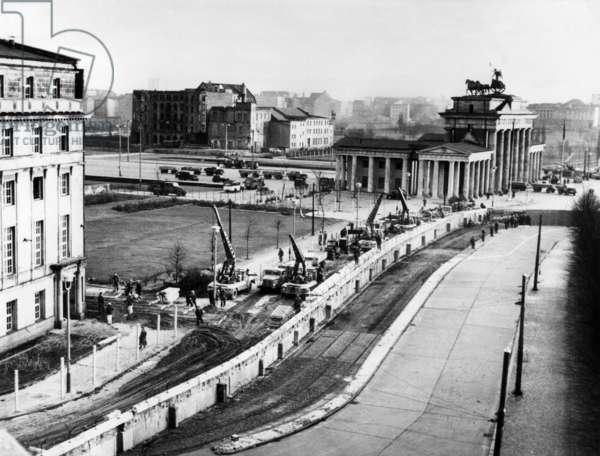 East germans strengthening Berlin wall under look of communist police near Brandeburg gate, 1961