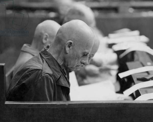 The High Command Trial in Nuremberg (1947 - 1948) : Wilhelm Von Leeb, reading for 1st time accusations : crime against humanity and against peace