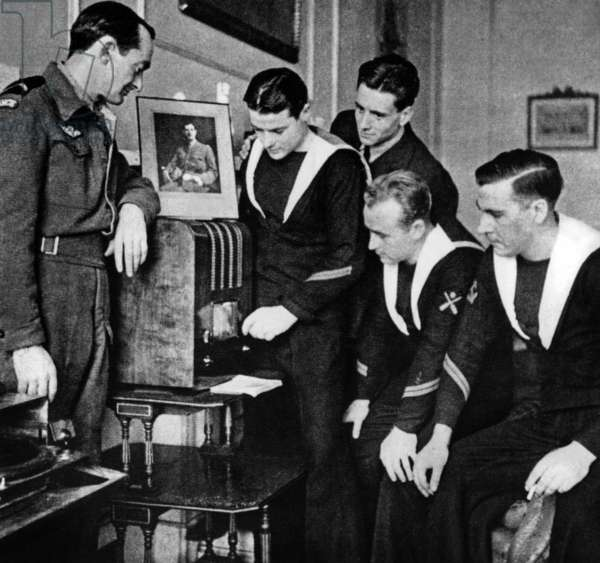 Members of FNFL (Free French Naval Forces) listening speech of French general Charles de Gaulle at the radio London, ww2