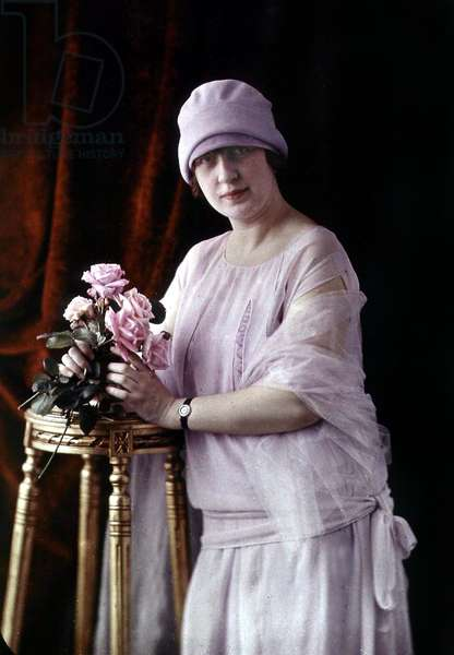 Young woman posing with a bunch of flowers, c. 1920, autochrome Lumiere (color photo on glass, 1st color photography process invented in1903)