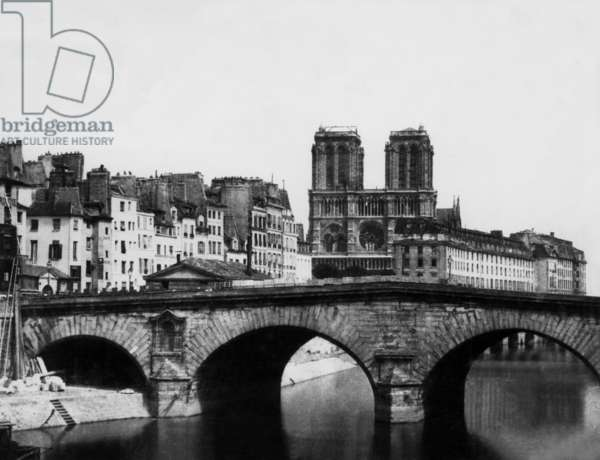 View of former bridge Saint Michel and in the background Notre Dame cathedral in Paris