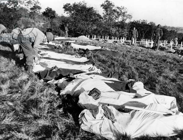 Shroud with bodies of soldiers dead durin Normandy Landings, cemetery near the beaches, Normandy, France, july 1944