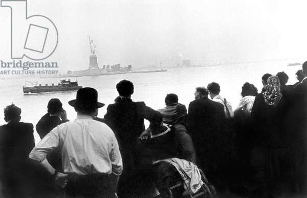 Arival of immigrants at Ellis Island, New York c. 1910