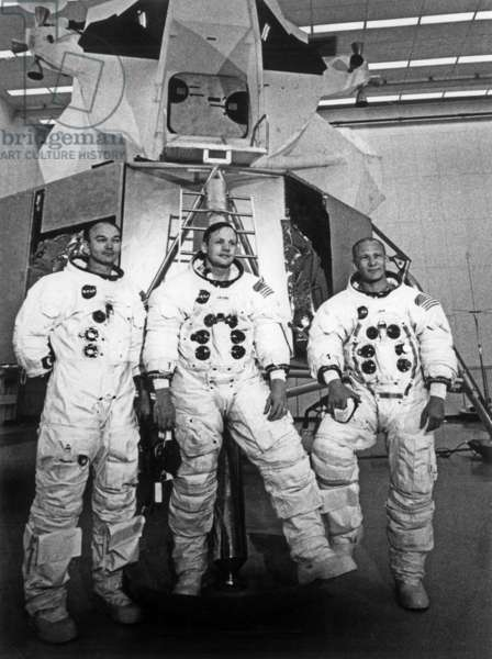 Mike Collins, Neil Armstrong and Edwin Aldrin of Apollo 11 mission posing in front of their lunar landing module simulator at Cape Kennedy, Florida, 1969, photo NARA