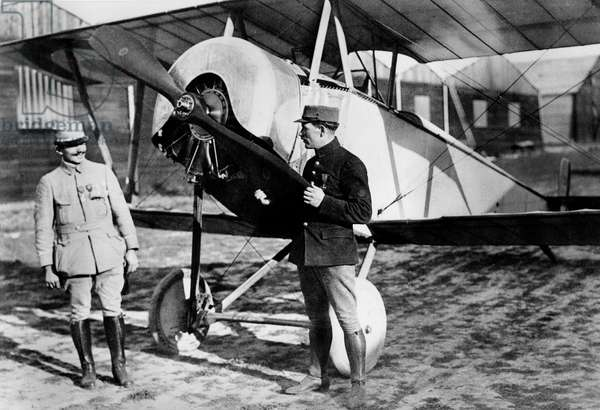 Ace aerobatics French pilot Adolphe Pegoud (1889-1915) with mechanic Lerendu c. 1915 in front of their Nieuport biplane