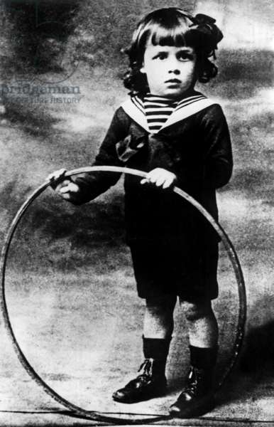 French writer Albert Camus (1913-1960) here as a child c. 1916 playing with a hoop