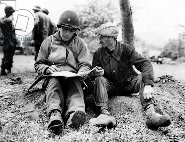 Normandy Landings, France, june 6, 1944 : a French civilian (Gustave Joret) is giving some geographical informations to an american officer, Le Hamel, Normandy, june 7, 1944