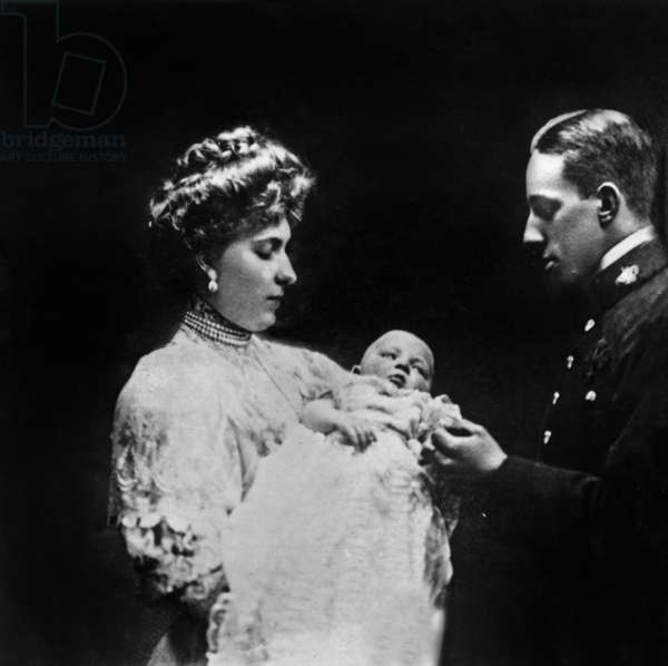 King of Spain Don Alfonso XIII and queen Victoria Eugenia with prince baby, Alphonse de Bourbon, in 1907