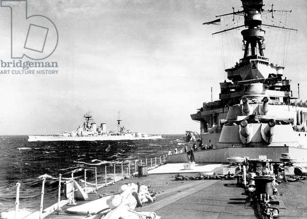 Royal Navy english warship Hood in front of warship Repulse december 1940