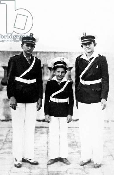 The three bothers Castro : Fidel Raul and Ramon wearing ragala uniform of the Dolores jesuit school in Santiago de Cuba in 1942