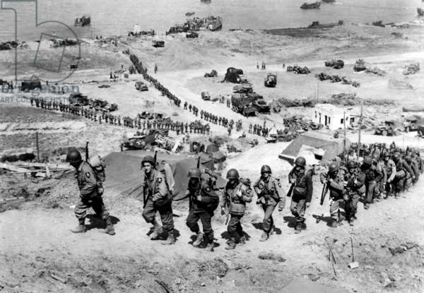 American reinforcement troops arriving in Ruquet, near Omaha Beach (Colleville sur Mer), on june 8, 1944, after Allied Normandy Landings in France, photo NARA