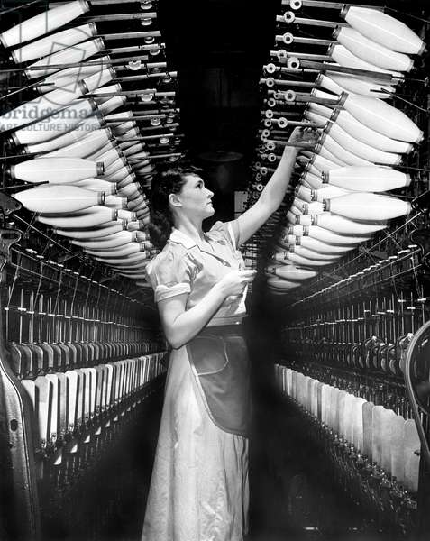 woman working in a nylon factory ((new material for parachutes) at Dupont's plant during ww2