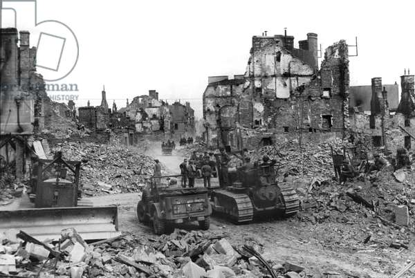 Invasion of Normandy : american bulldozers Caterpillar D7 cleaning the way in Saint Lo Normandy, France, july 30,1944 after the Liberation