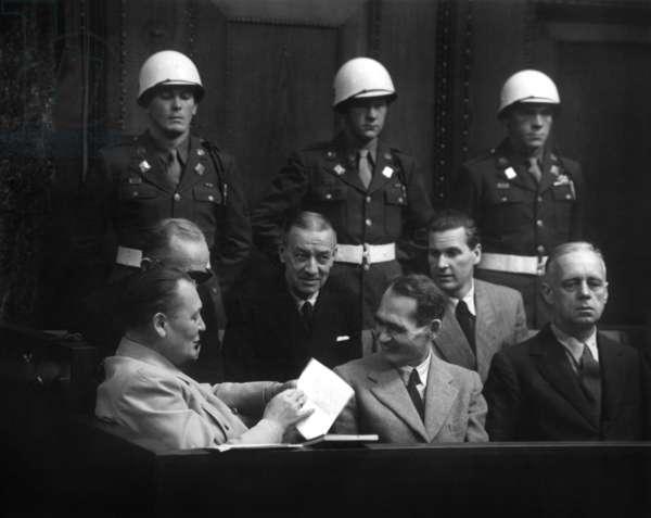 Nuremberg trial in 1945-1946 : Hermann Goering is joking with Rudolf Hess, and on right is Joachim Von Ribbentrop, december 6, 1945