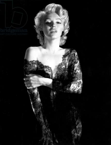 Marilyn Monroe wearing black lace negligee 1953