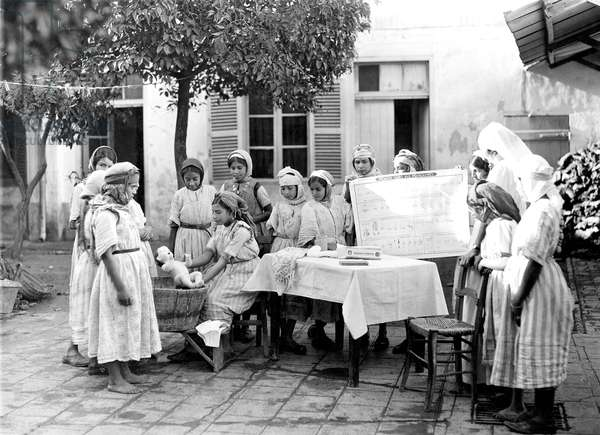 Young women during childcare lessons in Morocco, 30's
