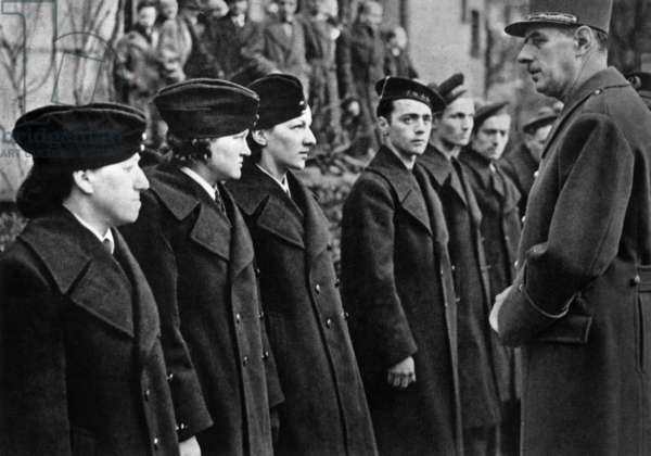 In London, 1942, general Charles de Gaulle meeting 1st contingent of volunteers from Saint Pierre et Miquelon (on r members of FNFL)