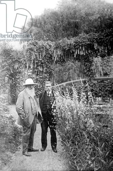 Claude Monet with writer Gustave Geffroy in his garden in Giverny, 1915