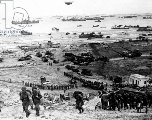 American reinforcement troops arriving in Ruquet, near Omaha Beach (Colleville sur Mer) on june 8, 1944, after Allied Normandy Landings in France (dirigible as antiaircraft defence), photo NARA