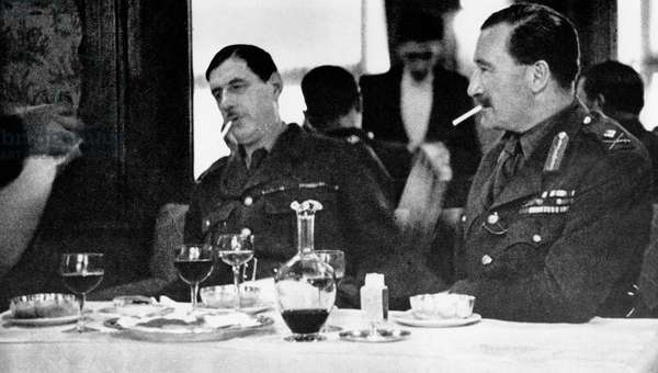 General Edward Spears (r) and general Charles de Gaulle during diner at the Coq d'Or in London in july 1940