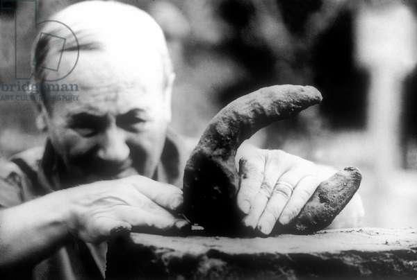 Joan Miro (1893-1983) in his workshop