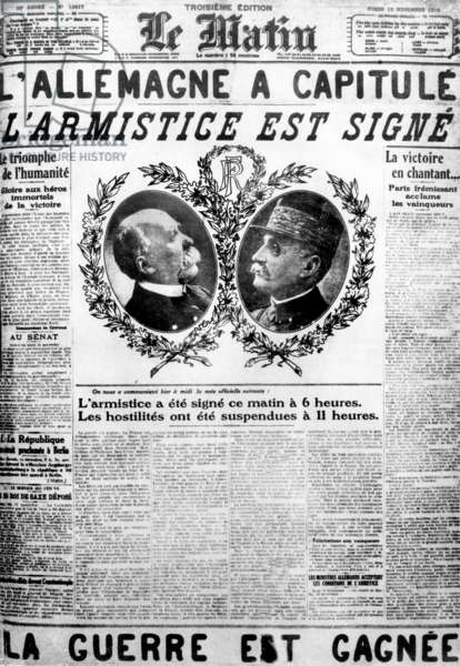 """Frontpage of French newspaper """"Le Matin"""" november 12, 1918, announcing the signature of armistice with portraits of Georges Clemenceau and Marshal Foch as French national heroes"""