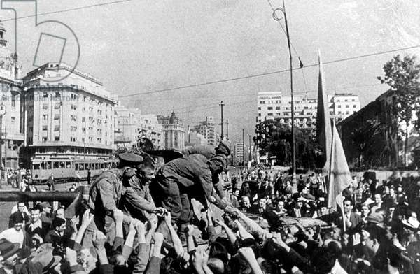 soviet tank servers greeted by the people in Bucarest, Romania, august 31, 1944