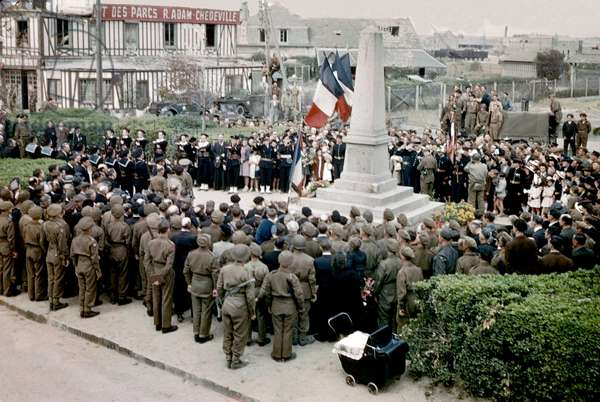 american and english soldiers among the local population during unveiling of war memorial in the village Courcelles sur mer in Normandy, France near Juno Beach c. spring 1945 after ww2