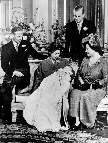 Princess Elizabeth with her son the prince of Wales Charles, in her arms, her father the king George VI of Great Britain and Irelandand her mother the queen Elizabeth and behind them her husband, Philip Mountbatten, duke of Edinburgh