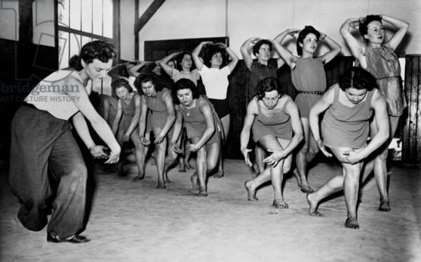 young girls in France during the Occupation, 1941 : rhythmic dance lesson in Paris february 05, 1941 (at the time of the Vichy government)
