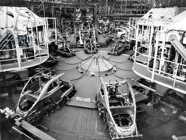 Assembly line for Bug Beetle car in Volkswagen factory plant c. 1950