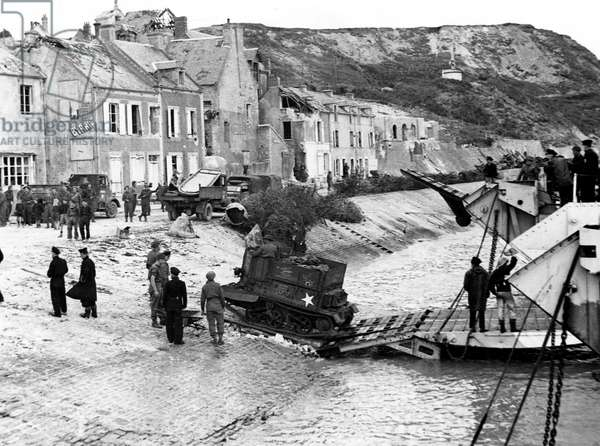 A few day after Normandy Landings, june 10, 1944 : english troops landing equipement from LST in Port en Bessin