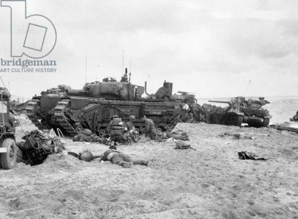 Normandy Landings, june 6, 1944 : english soldiers and an artillery tank Churchill AVRE on Sword Beach, male nurses medics giving first aid to the wounded